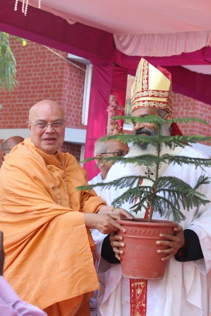 43.Swamji offers a plant to Abp Thomas